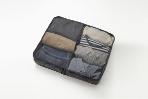 Mesh see-through packing cube full of rolled clothes